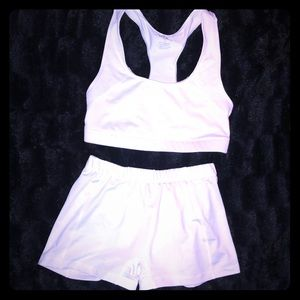 BCG brand white sports bra and spandex.